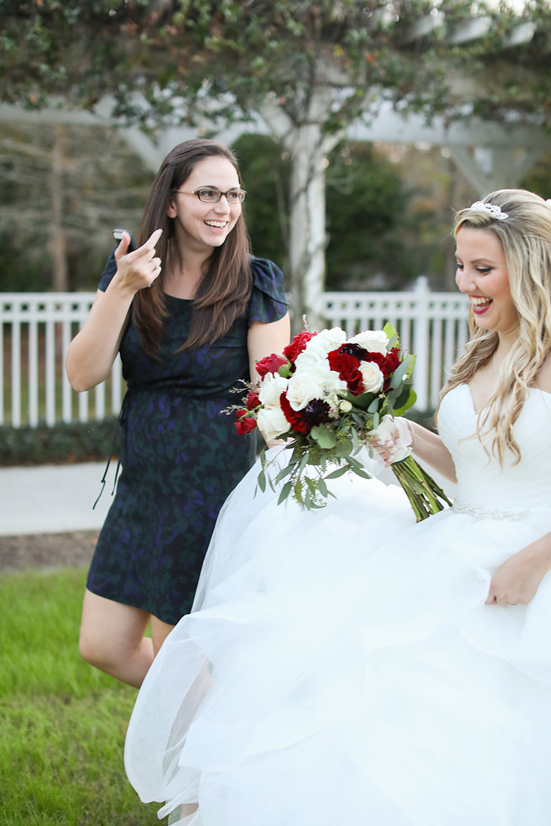 Paige of Two Peas Events assists bride during wedding coordination
